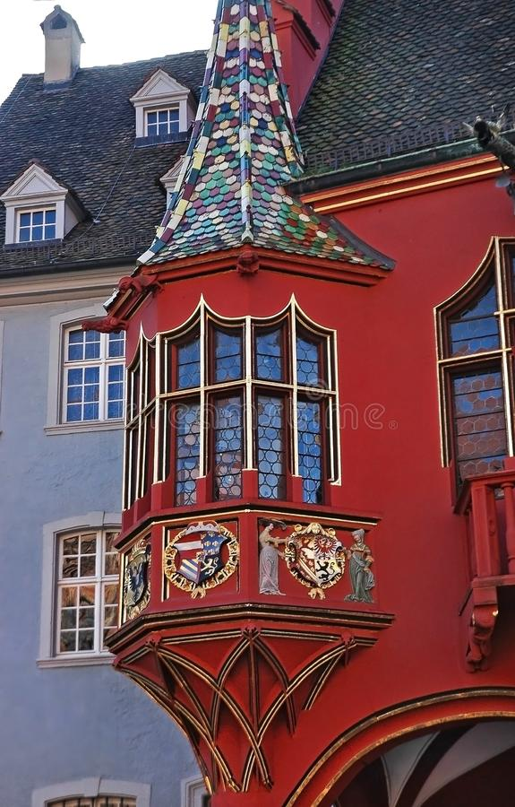 Part of old Historical Merchants Hall facade, Freiburg im Breisgau, Germany. Amasing colorful details of the Historical Merchants Hall Kaufhaus facade in stock photos