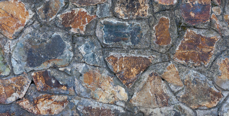 Part of old stone wall close-up. Textural background royalty free stock images