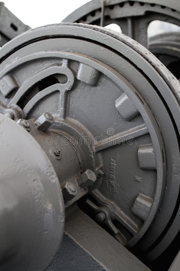 Part of Old Winch lifting Mechanical Anchoring. Part of Old Winch lifting Mechanical Anchoring of large ship have a big chain and gear cog royalty free stock images