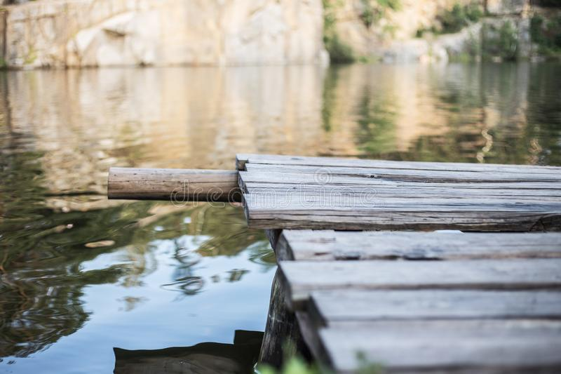 Part of old wooden bridge. Bridge near the clean water stock photo
