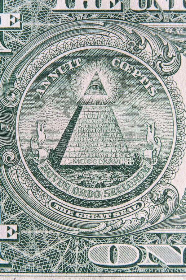 Part of one dollar note with great seal super macro shot. Eye of Providence or all-seeing eye sign, detail in th banknote of one. Part of one dollar note with royalty free stock photos