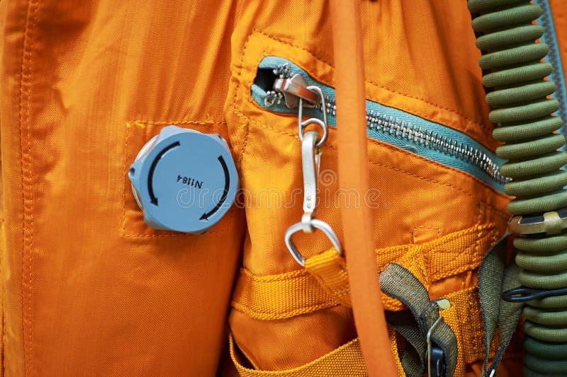 Part of orange astronaut uniform, closeup. Cosmonaut protective suit. Part of orange astronaut uniform, close up. Cosmonaut protective suit stock photography