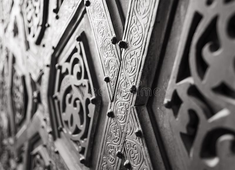 Part of the ornaments of the bronze-plate door of Sultan Qalawun mosque, al Moez street, Cairo, Egypt. Part of the ornaments of the bronze-plate door of Sultan stock photo