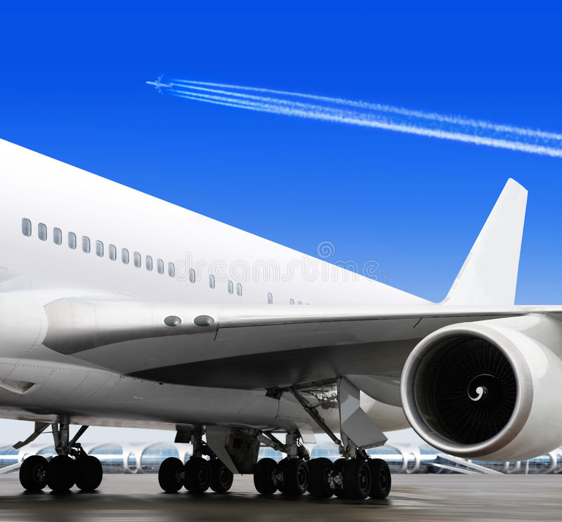 Part of plane in airport. Turbine of big passenger plane that waiting for departure in airport royalty free stock images
