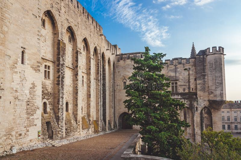 Part of Pope`s Palace in Avignon. Fragment of wall of Papal Palace in Avignon, France. Former residence of Pope in 14th century is the largest medieval fortress stock photography