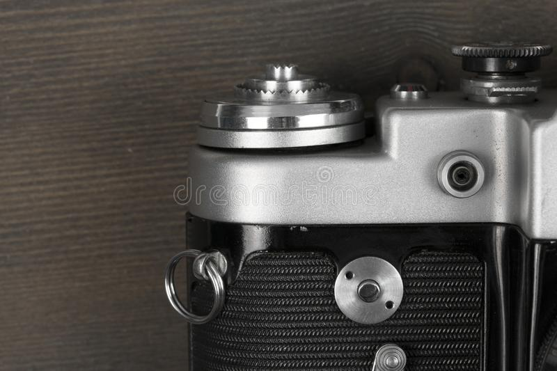 Part of the rangefinder classic manual film camera on wood background stock photography