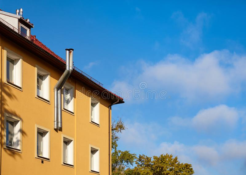 Part of a residential building with heating system pipes royalty free stock photo