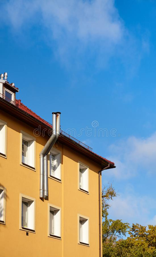 Part of a residential building with heating system pipes stock image