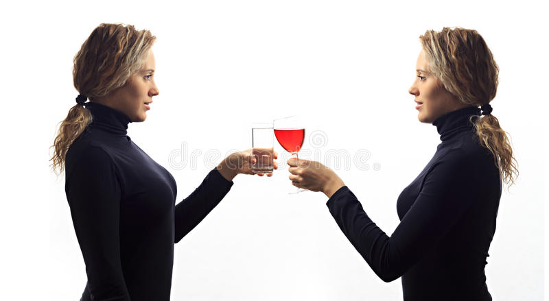 Part of series. Self talk concept. Portrait of young woman talking to herself in mirror, drinking milk or wine in glass stock image