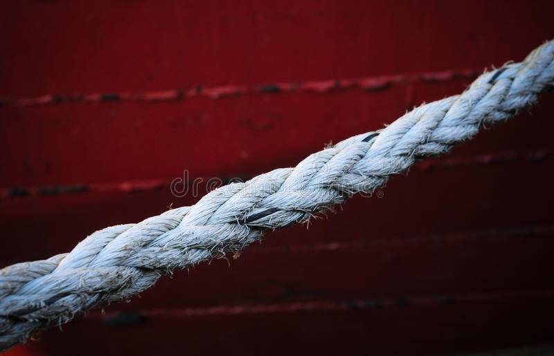 Part of a ship. Rope for the tie-down of karabley in the harbour of ivozle pier stock images