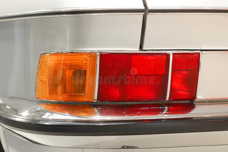 Part of silver oldtimer with rear light royalty free stock photography