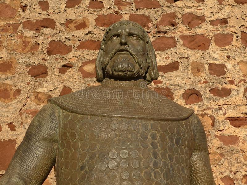 Statue of King Sancho I. at the entrance into medieval castle of Silves, Algarve. Part of the Statue of King Sancho I. at the entrance into medieval castle of royalty free stock images