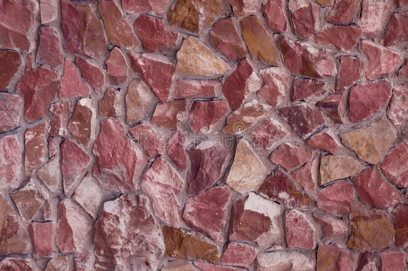 Part of a stone wall, for background or texture. Part of a red stone wall, for background or texture stock image