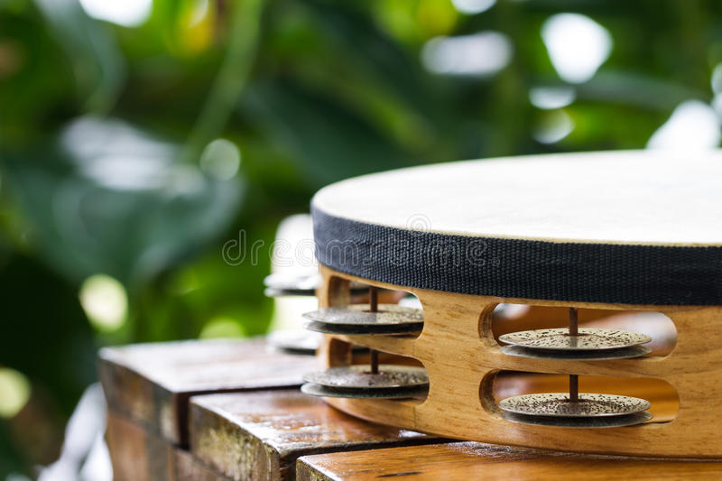 Part of tambourine. Tambourine on wood table in garden royalty free stock photos