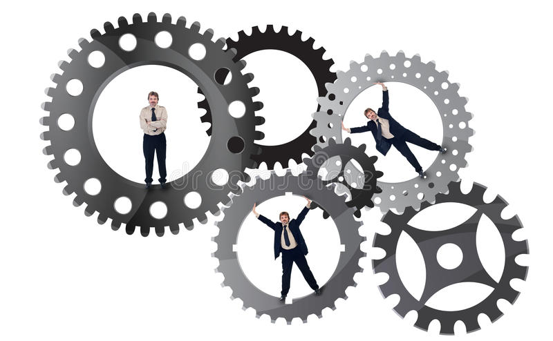 Part of the team effort concept. With businessman inside cogwheels royalty free illustration