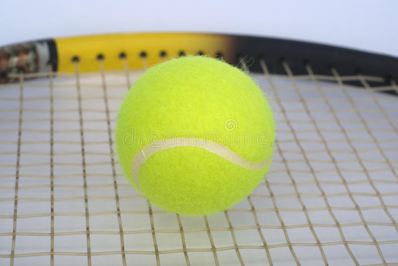 Part Of Tennis Racquet With Yellow Ball Clo Stock Images