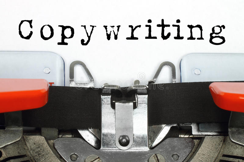 Part of typing machine with typed copywriting word. On white paper royalty free stock photography