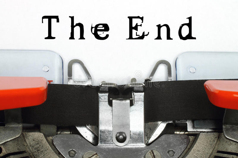 Part of typing machine with typed The End words stock image