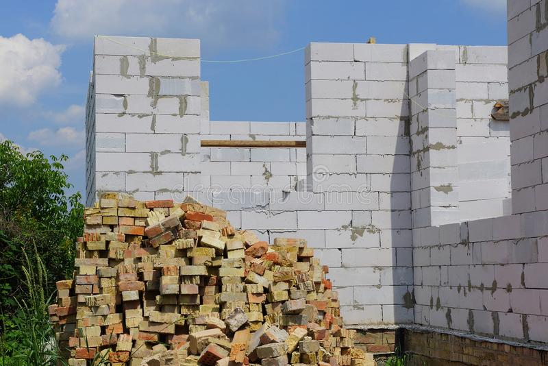 Part of an unfinished house on a white brick building site royalty free stock images