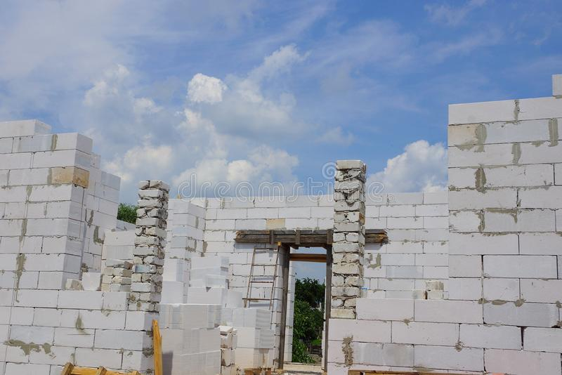 Part of an unfinished house on a white brick building site stock image