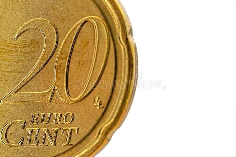 Part of a used 20 Euro Cent coin extreme close-up. Visible part of the coin is the number 20 and the text Euro Cent, isolated on white background stock photo
