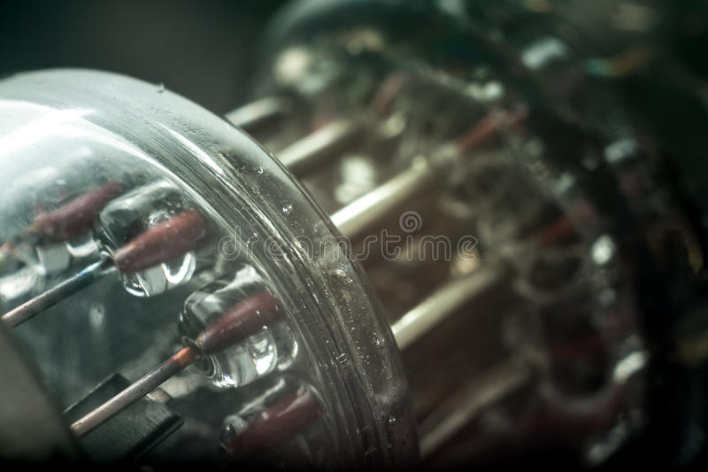 Part of vacuum lamp. Rare vacuum tubes close-up. Abstract vintage technology background royalty free stock photography