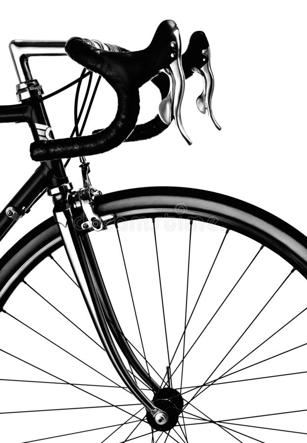 Part of the vintage road bike. Steering, brakes and front wheel. Black and white sports style isolated on white background stock images