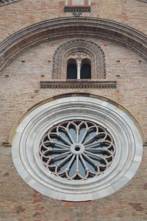 Part of a wall with the rose window of the Cathedral of Crema in the province of Cremona in Lombardy (Italy) stock photos