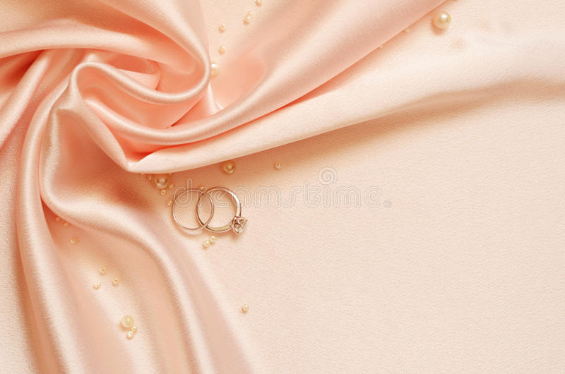 Satin Drapery With Pearls And Wedding Rings Royalty Free Stock Photos