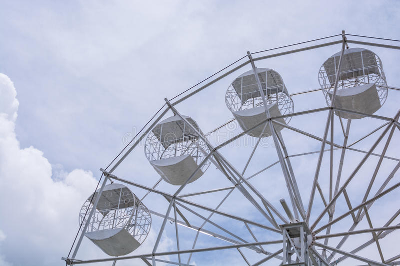 Part of white Ferris Wheel on cloudy Sky royalty free stock images