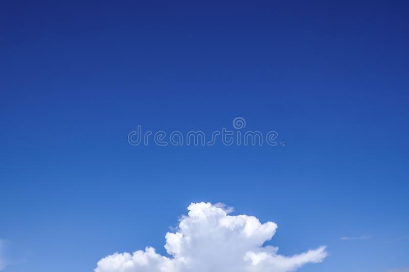 Part of white fluffy clouds on clear blue sky nature background stock photography