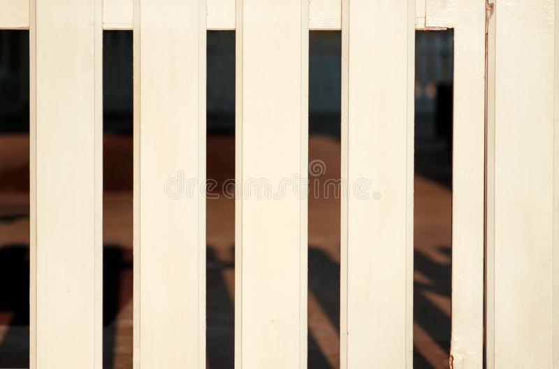 Part of white wooden decorative fence isolated. Wooden plank panel background texture. Landscape architecture ideas, details. Part of white wooden decorative stock image
