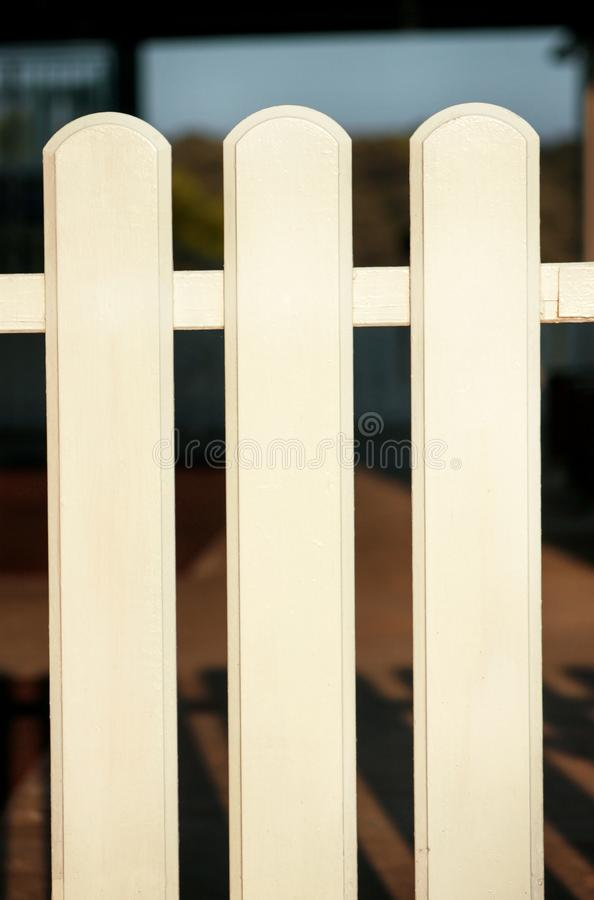 Part of white wooden decorative fence isolated. Wooden plank panel background texture. Landscape architecture ideas, details. Part of white wooden decorative royalty free stock photo