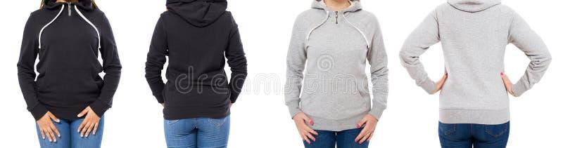 Parte anteriore e vista posteriore - donna femminile della ragazza in maglia con cappuccio nera grigia isolata su fondo bianco fotografia stock