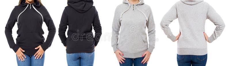 Parte anteriore e vista posteriore - donna femminile della ragazza in maglia con cappuccio nera grigia isolata su fondo bianco fotografia stock libera da diritti