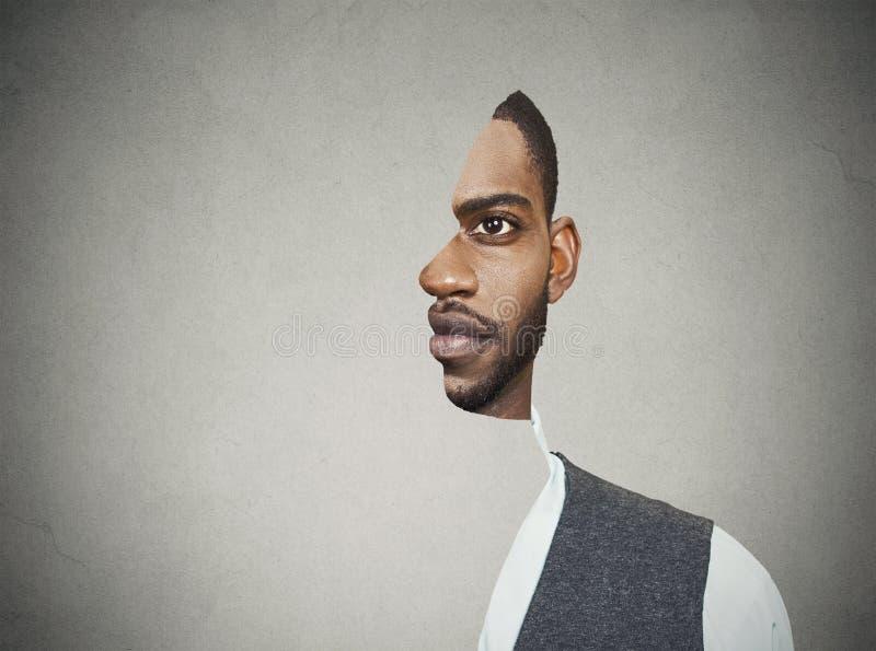 Parte anteriore surrealista del ritratto con il profilo tagliato di un giovane fotografie stock libere da diritti