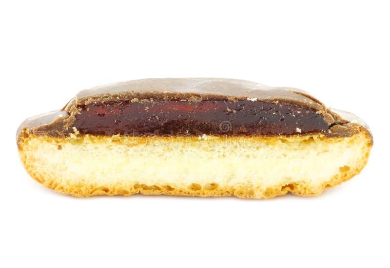 Parte de bolinho da geléia com esmalte do chocolate imagem de stock royalty free