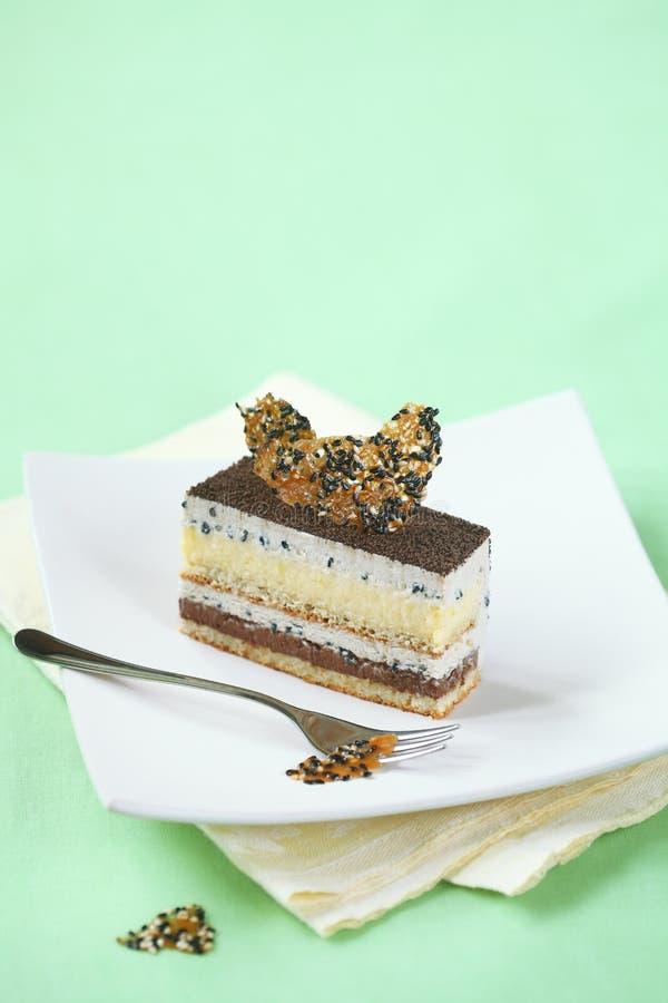 Parte de bolo de Entremet do cal do sésamo foto de stock