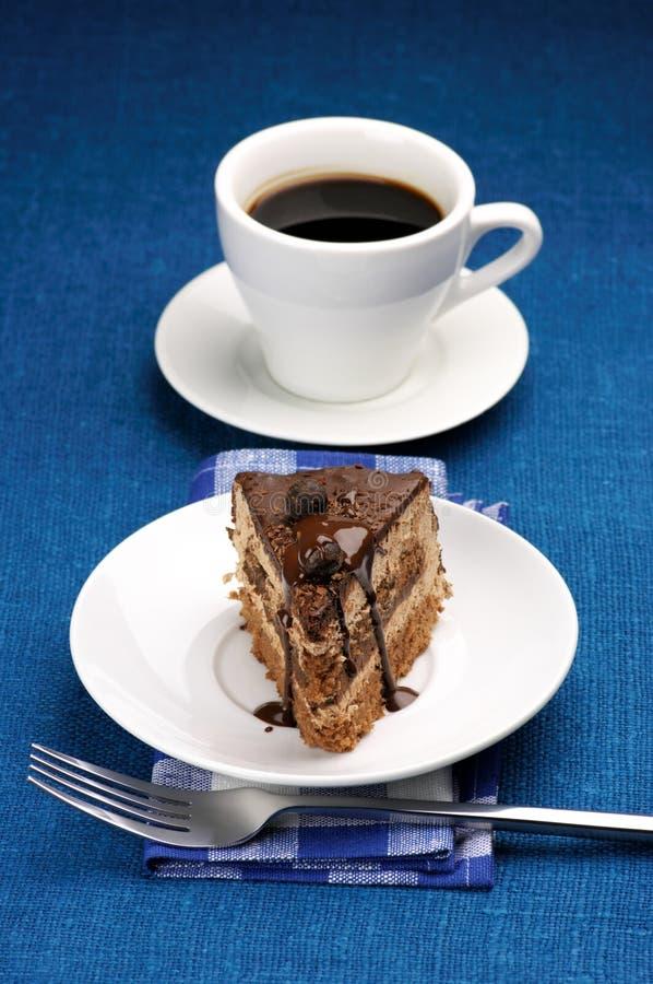 Parte de bolo e de café imagem de stock