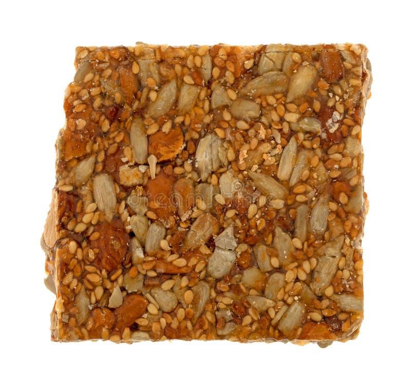Parte de doces da trituração da porca do mel em um fundo branco imagem de stock royalty free