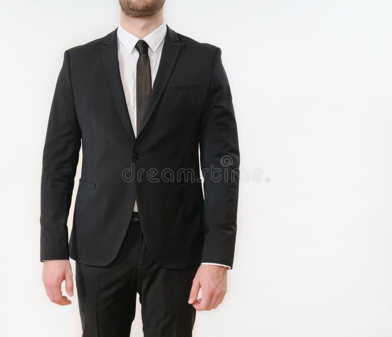 Parte del cuerpo del hombre de negocios en traje negro fotografía de archivo
