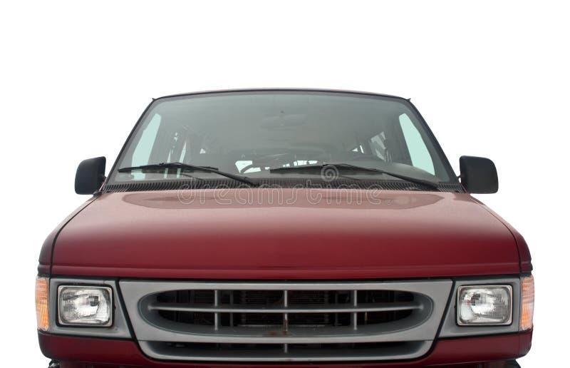Parte delantera de una furgoneta roja en el fondo blanco foto de archivo