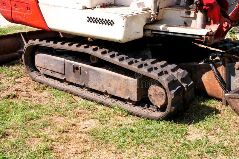 Parte dell'escavatore, della macchina del bulldozer e del trattore del lavoratore, primo piano Rinnovamento sul modo Macchinario  immagini stock