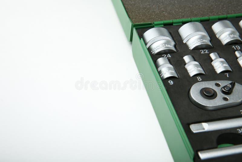 Parte della cassetta portautensili su fondo bianco fotografia stock libera da diritti