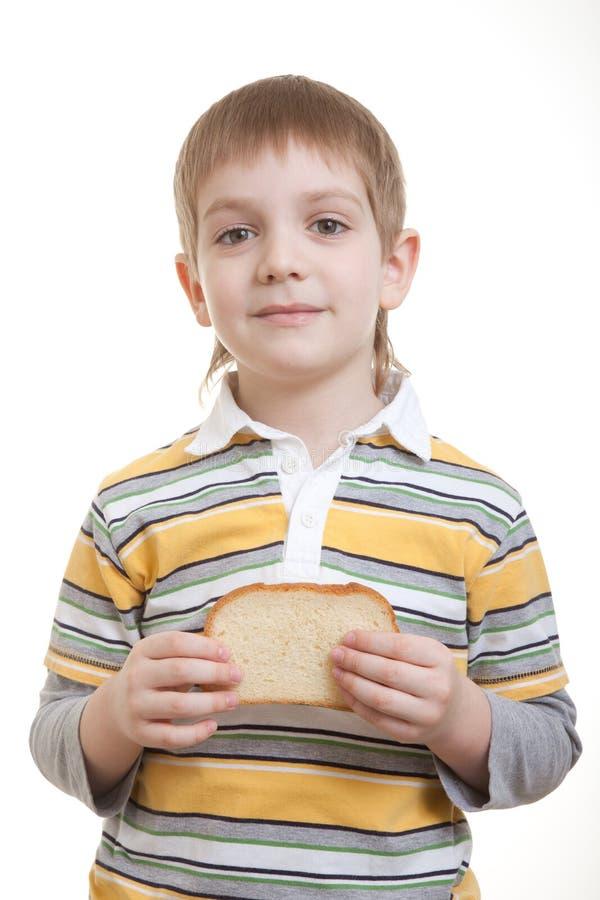 Parte della holding del ragazzo di pane fotografie stock libere da diritti