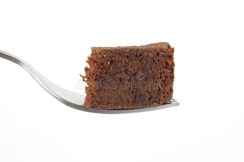 Parte della torta di cioccolato sulla forcella fotografia stock