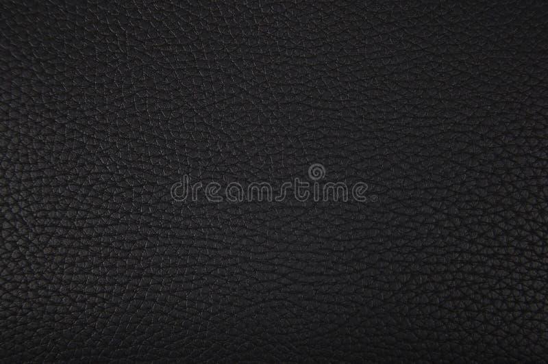 Parte do close up de couro preto da textura foto de stock