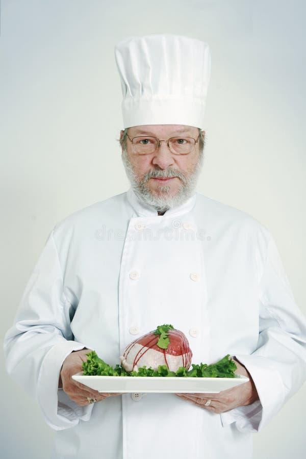 Parte do cozinheiro chefe e da carne fotos de stock