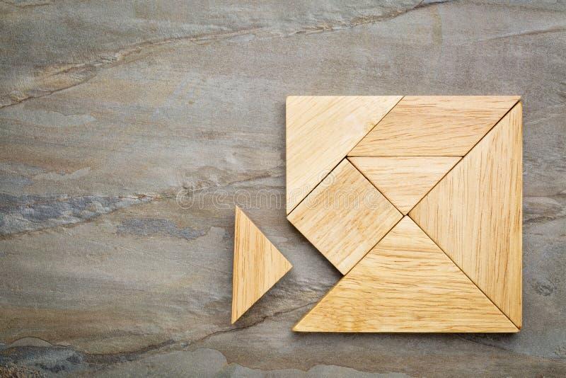 Parte faltante no enigma do tangram fotos de stock royalty free