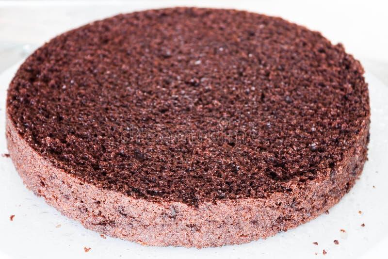 Parte inferior de la torta de chocolate de la gasa imagen de archivo